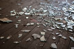 Pieces of shattered glass or mirror. In an abandoned house Royalty Free Stock Image