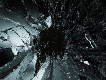 Pieces of shattered or smashed glass on black Stock Images