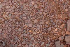 Small crushed clay with larger brick mixed in. Pieces of small crushed clay brick and tile fragments, with larger chunks of brick mixed in, and with some of the Stock Photo