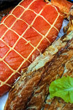 Pieces of smoked fish exposed to sale Royalty Free Stock Images
