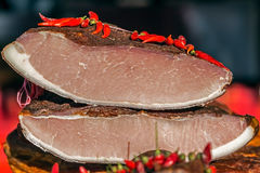 Pieces of smoked pork bacon and ham overlapping Stock Photos