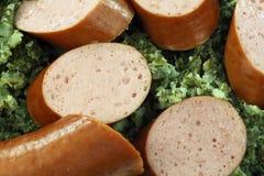 Pieces of smoked sausage Stock Photos