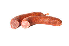 Pieces of smoked sausage. Lie on a table Royalty Free Stock Images