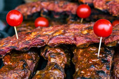 Pieces of steak decorated with tomatoes Royalty Free Stock Photos