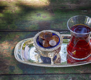 Pieces of sugar and tea Turkish cup Stock Images