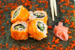 4 pieces of Sushi roll and caviar on nori Royalty Free Stock Photography