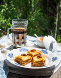Pieces of sweet baklava, garden background, selective focus Royalty Free Stock Photo