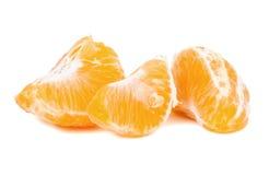 Pieces of tangerine on white background Stock Photo
