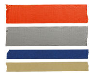 Pieces of Tape. Orange, Blue, Grey and yellow pieces of tape from the top view isolated on a white background royalty free stock photography