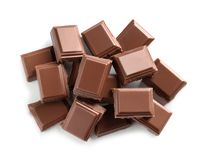 Pieces of tasty milk chocolate on white background stock photography