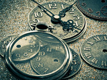 Pieces of Time. Close-up of pocket watch faces and hands Stock Photography