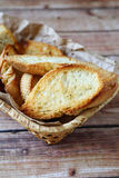Pieces of  toasted bread in a basket Royalty Free Stock Images