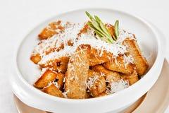 Pieces of toasted parmesan garlic bread Stock Photos