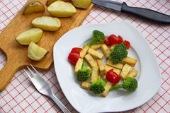 Pieces of tofu served with broccoli, tomatoes and baked potatoes Stock Photos
