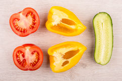 Pieces of tomato, sweet pepper and cucumber on wooden table. Top view stock photos