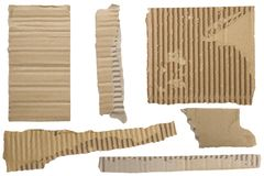 Pieces of torn brown corrugated cardboard Royalty Free Stock Images