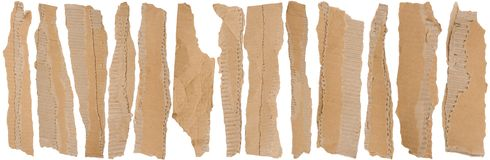 Pieces of torn brown corrugated cardboard Royalty Free Stock Photos