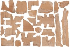 Pieces of torn brown corrugated cardboard Stock Photo