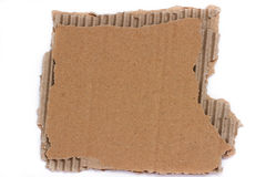 Pieces of torn brown corrugated detailed cardboard Stock Images