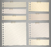 Pieces of torn brown lined note paper with Royalty Free Stock Photography