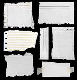 Torn paper. Pieces of torn paper on black. Copy space royalty free stock photo