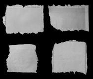 Torn papers on black. Pieces of torn paper on black Stock Images