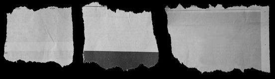 Torn papers on black. Pieces of torn paper on black Royalty Free Stock Photo