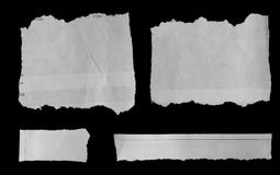 Torn papers on black. Pieces of torn paper on black Royalty Free Stock Photography