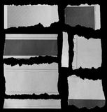 Torn papers on black. Pieces of torn paper on black Royalty Free Stock Image