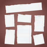 Pieces of torn white lined note paper with sticky tape on diagonal dark background Stock Photos