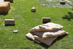 Pieces of tree trunk and sacks Stock Photo