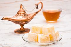 Pieces of Turkish Delight on a plate and cup of tea Stock Photography