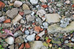 Pieces of the used broken concrete and bricks pollute the forest surface. Background royalty free stock photos