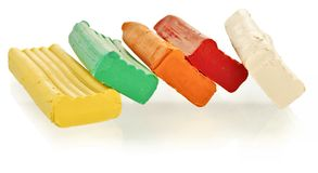 Pieces of varicoloured plasticine. Pieces of varicolored plasticine on a white background Stock Image