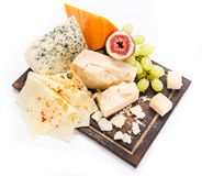 Pieces of various cheeses on white background Stock Image