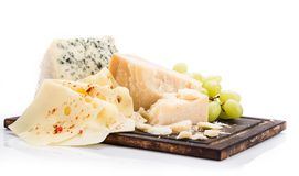 Pieces of various cheeses on white background Stock Photography