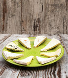 Pieces of various types of cheeses Royalty Free Stock Images