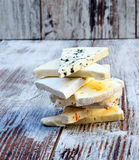 Pieces of various types of cheeses Stock Photos