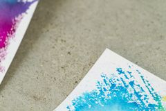 Paper with watercolor paint in blue tones on cement background stock image