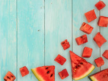 Pieces of watermelon on blue wooden table Royalty Free Stock Photos