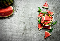 Pieces of watermelon in a bowl with mint. Royalty Free Stock Images