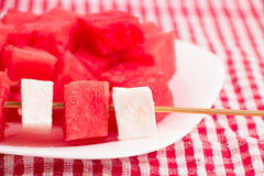 Pieces of watermelon and white cheese on sticks , with watermelon plate Royalty Free Stock Photography