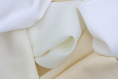 Pieces of white and beige textile. Full frame Royalty Free Stock Photography