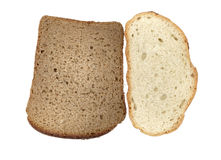 Pieces of white and black bread. Lie on a table Stock Images