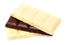 Pieces of white and black porous chocolate Stock Photos