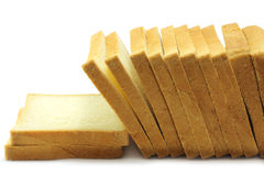 Pieces of white bread. On a white background Royalty Free Stock Photos