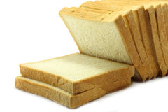 Pieces of white bread. On a white background Royalty Free Stock Photography
