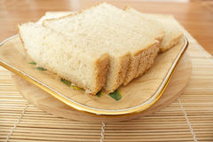 Pieces of white bread on a plate Stock Image