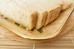 Pieces of white bread on a plate Stock Photo