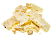 Pieces of white chocolate with hazelnuts close up Stock Photo